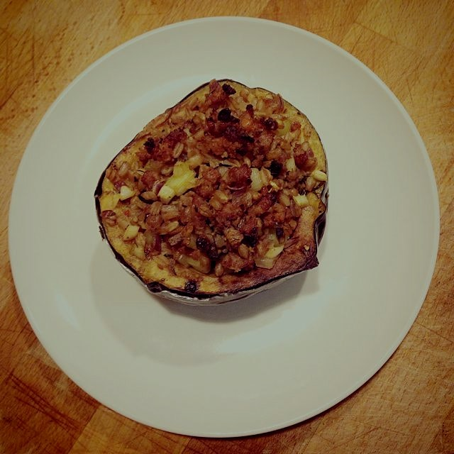 Roasted acorn squash with sausage and farro stuffing. Yum!