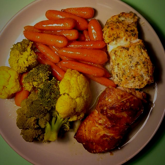 I did salmon 2 ways: teriyaki glaze and Parmesan cheese w/ lemon! The mixed veggies are curries a...