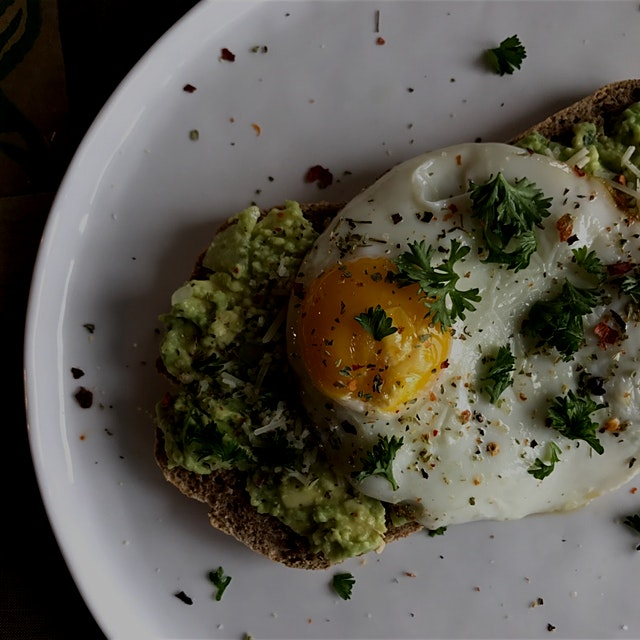 Day 8/30: Eat Real Food Level IV  Avo toast with onions jalapeños and topped with an egg. The toa...