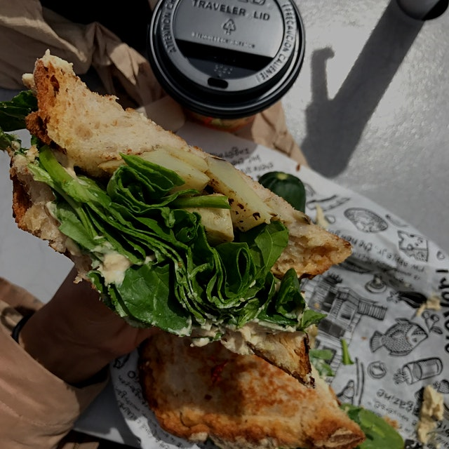 This was a delicious vegetarian sandwich full of hummus, spinach, artichoke, and roasted red pepp...