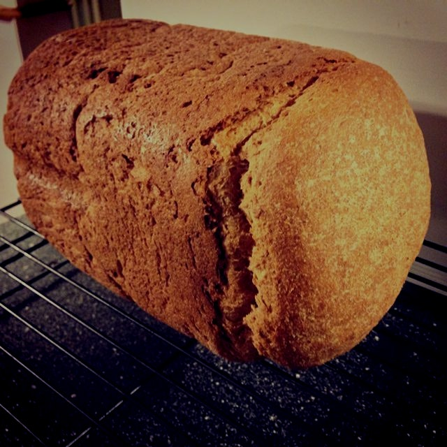 Fresh honey whole wheat bread just out of my bread machine. My house smells amazing- my monsters ...