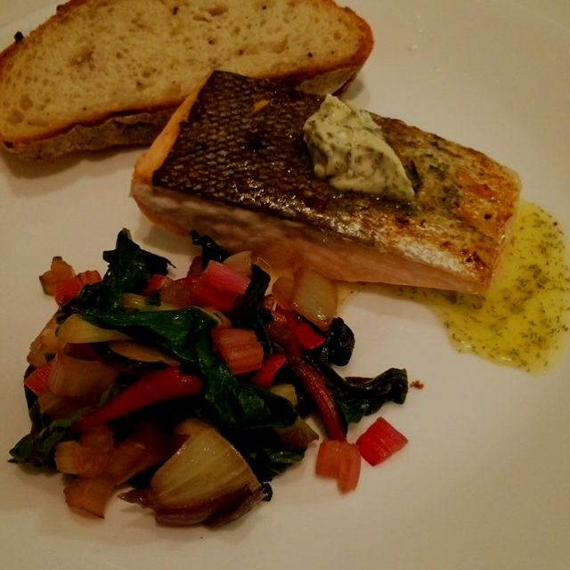 Salmon sautéed on its skin with herb butter and chard for dinner!