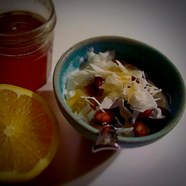 Yogurt bowl with almonds, almond butter, orange, local basswood honey, and organic coconut. Wood/...