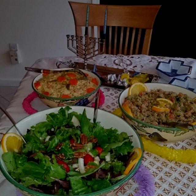 Hanukkah buffet, salad section :Potato Salad, mediteranian quinoa salad and mixed greens salad.