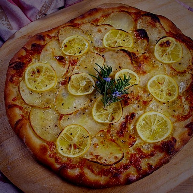 Just baked! Our Artisanal Meyer Lemon and Potato Pizza! Click: http://www.craftybaking.com/recipe...