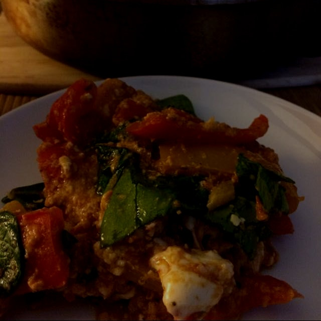 Turkish menemen with spinach, peppers, and cheese