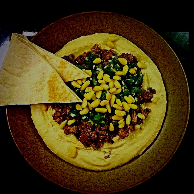 Hummus Kawarma, from Jerusalem cookbook. Spicy  ground lamb with an herby lemon sauce & pine nuts...