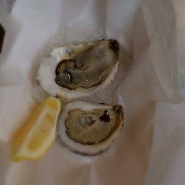 Two lonely oysters Sitting in some ice - at the Ed's Lobster Bar Outpost at Gansevoort Market @Br...