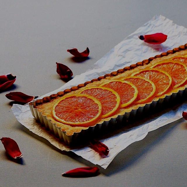 Homemade fruit tart with cara cara orange slices on top and Orange zest/ juice inside.