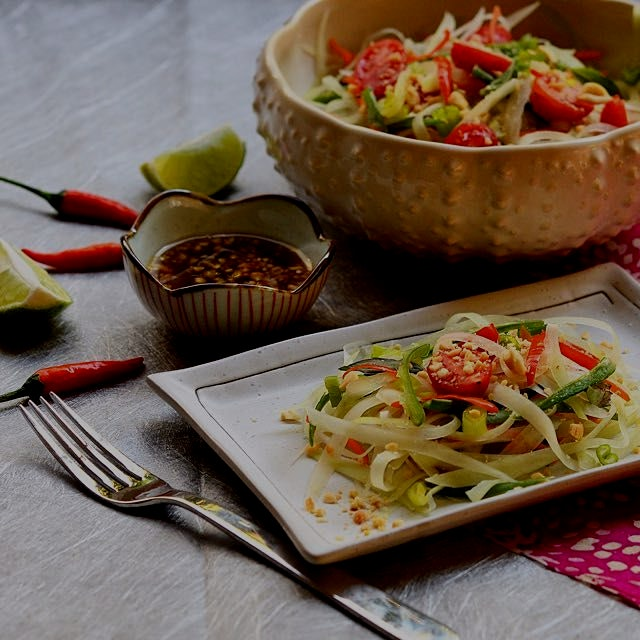 Thai green papaya salad with an intensely sweet and tangy dressing with a little kick of heat.