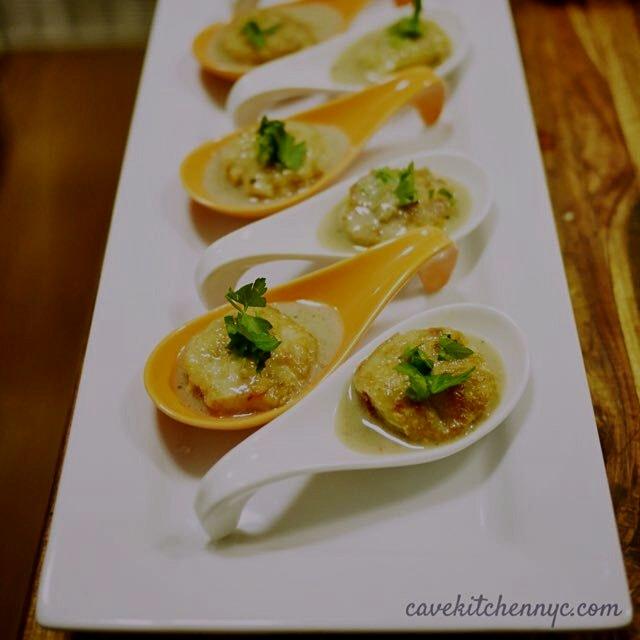 Bites of lemongrass shrimp balls in coconut coriander broth. Made with wild Argentinian shrimp wi...