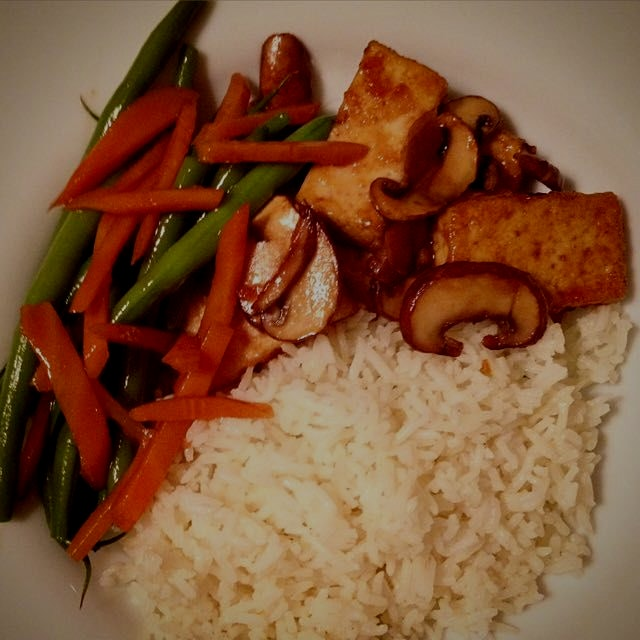 Teriyaki tofu with mushroom. Served with fluffy basmati rice and steamed green bean and carrot. O...