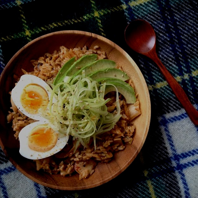 Kimchi fried rice: brown rice, homemade kimchi, topped with hard boiled egg, avocado and quick pi...