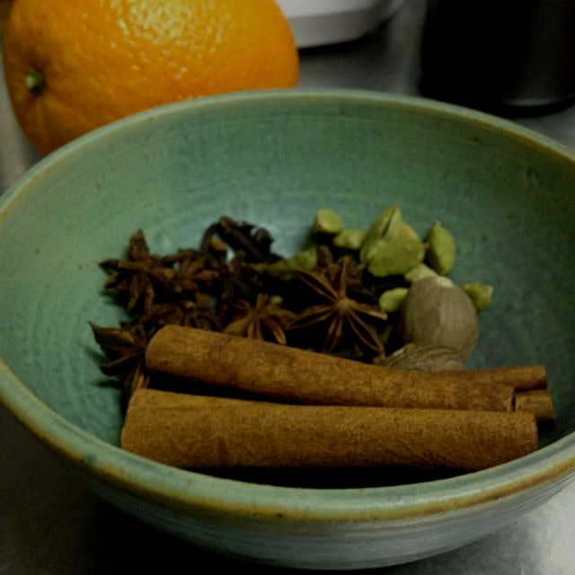Makings for chai inspired mulled wine. Orange peel, cardamom, cinnamon sticks, star anise and clo...
