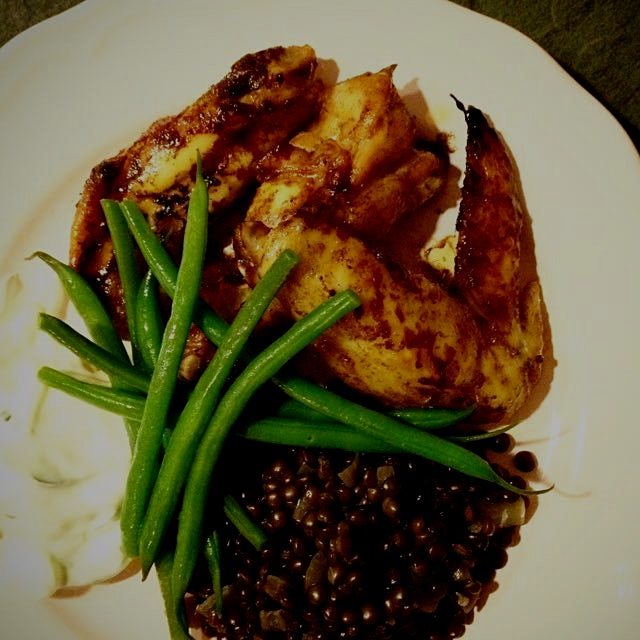 Baked sticky chicken wings, marinated in tamari, mirin, honey and sesame oil. Served with lentils...