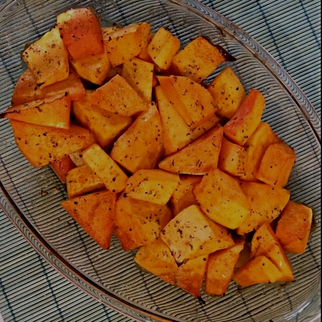 Roasted pumpkin over a bed of carrot and potatoes. Trying new flavors. Pumpkin isn't very common ...