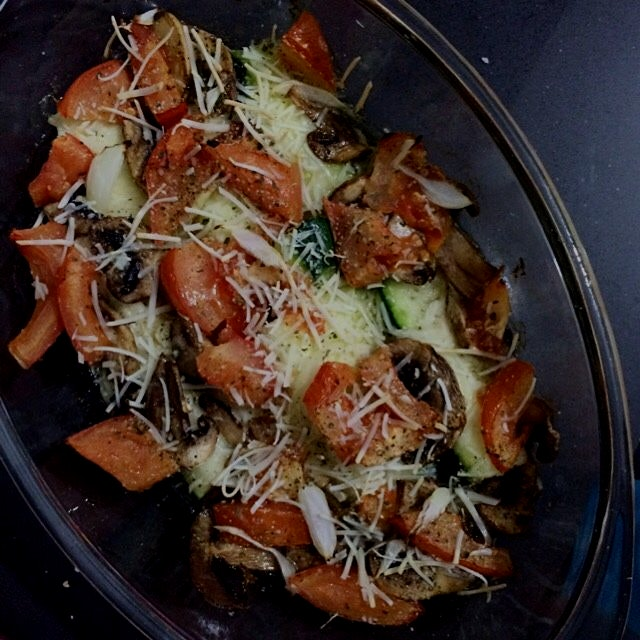 Delicious roasted  zucchinis with grated parmesan cheese, tomatoes, onion, mushroom and oregano d...