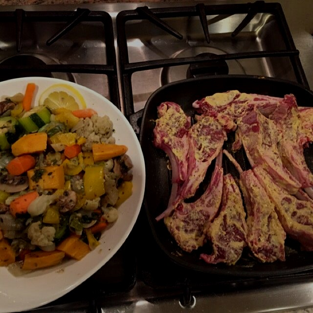 Lamb chops prepped with English mustard .  Soon and once cooked will join the vegetables on the d...
