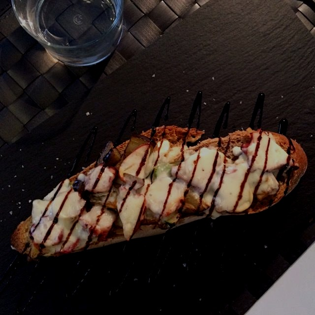Delicious toast with octopus, vegetables and Tetilla cheese. This is a kind of Galician cheese. L...