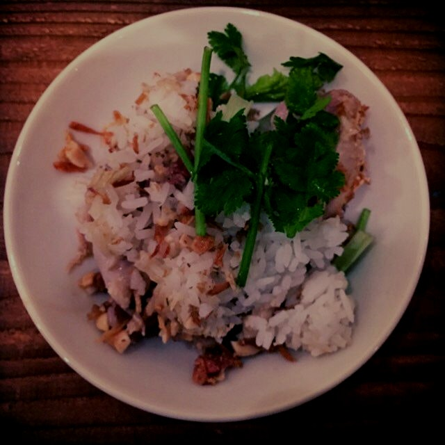 Beautifully simple steamed chicken with coriander and a vinegar and fish sauce here at Irodori in...