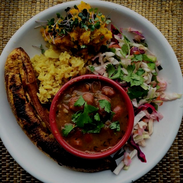the complete plato: Colombian-style red cagamanto beans, roasted platano, cabbage slaw, mashed ro...