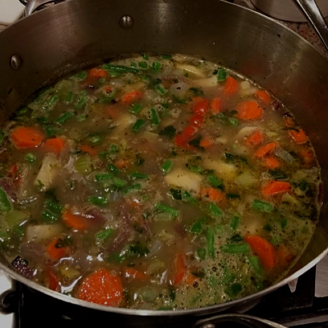 Snowing outside yet again... Making a home vegetable soup remedy