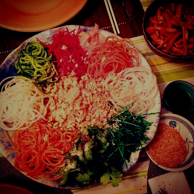 A traditional Malaysian Chinese New Year dish - Yee Sang. Raw fish salad made with salmon, veggie...