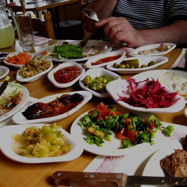 Typical lovely Middle eastern salads and pickles served as pre meal snacks in Israel