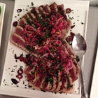 Seared Tuna Agro-dulce, a Sicilian favorite with pickled red onions, olives, and mint