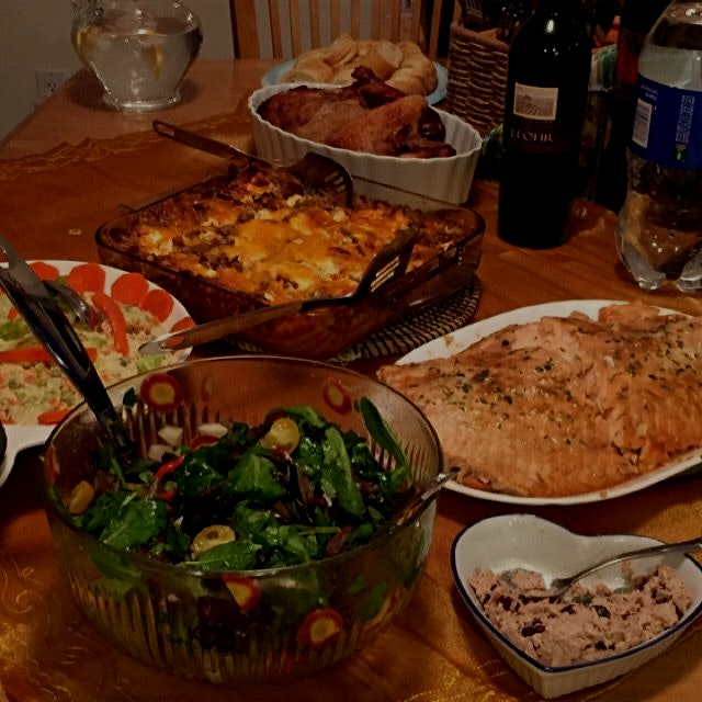 Beef lasagna, baked salmon and salads for home movie party