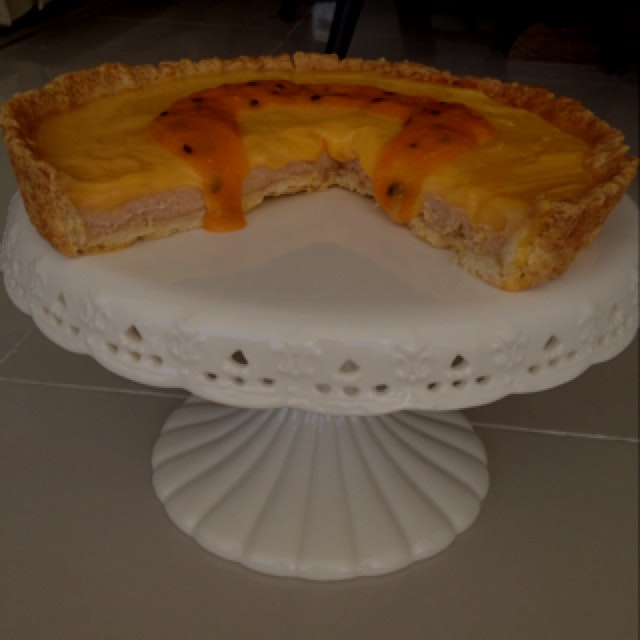 Mamey sapote custard tart with passionfruit curd and passionfruit mango sour orange coulis.  Pret...