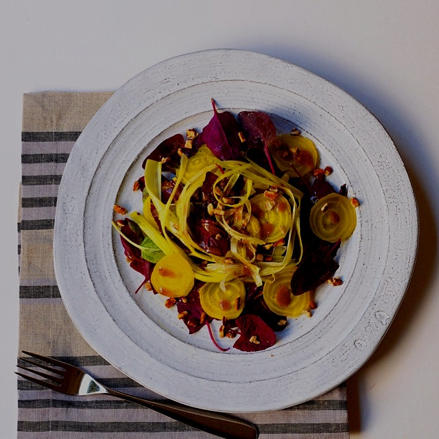 A spring welcoming salad: beets, roasted leeks and heirloom spinach tossed with a balsamic mustar...