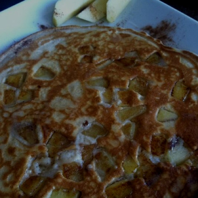 Apple cinnamon pancakes with maple syrup.