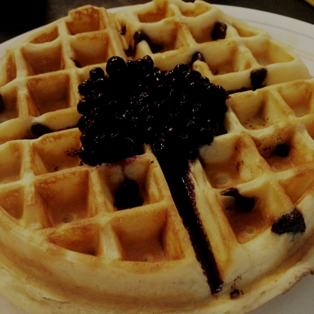 Belgian waffles with chocolate chips and blueberry syrup