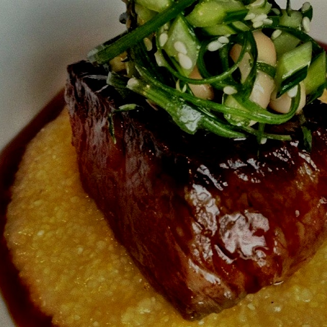 Mirin braised short rib with pickled bok choy and sesame polenta