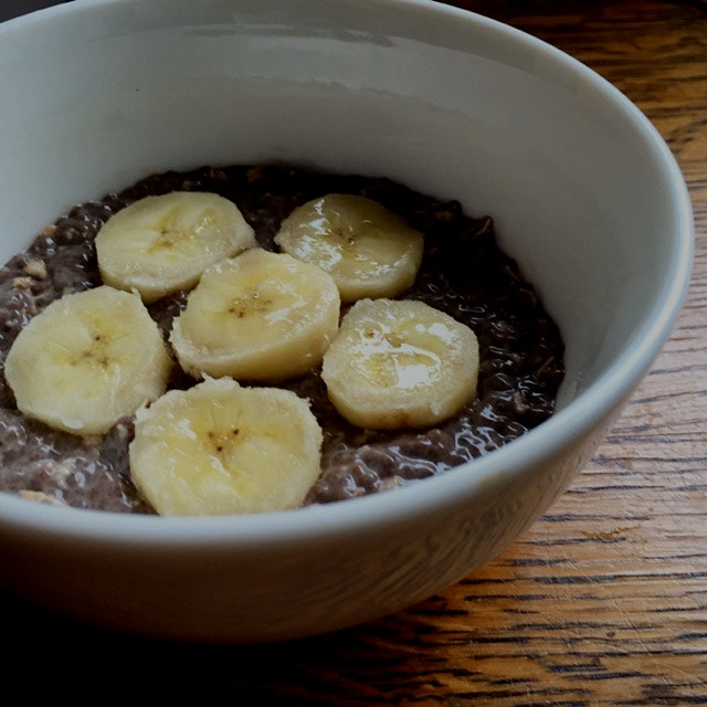 Dark chocolate peanut butter chia (and oatmeal) pudding with sliced banana for breakfast