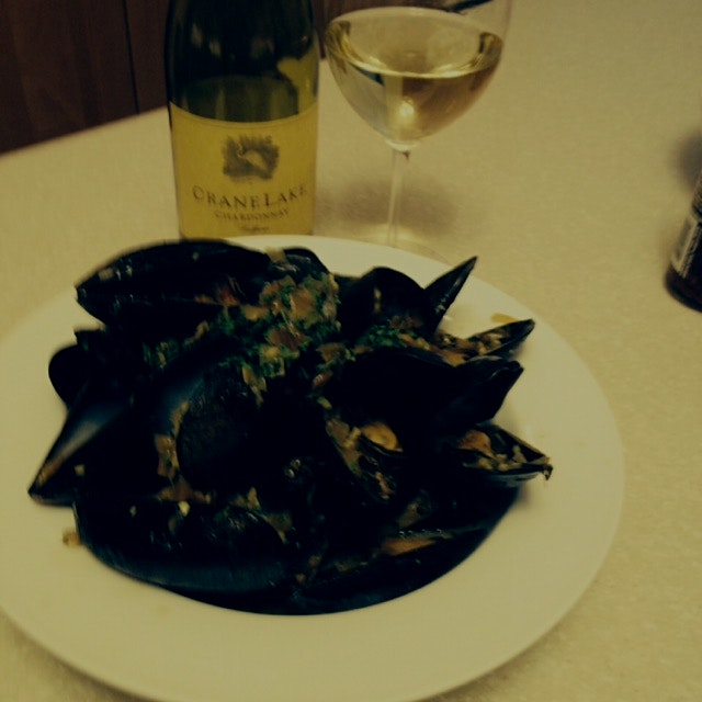 My friend Lisa's home made mussels with saffron , served with chilled white wine. Sooner or later...