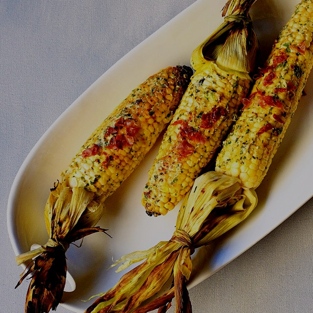 Fired up my grill today: grilled white corns dressed up with a homemade buttery smear of queso fr...