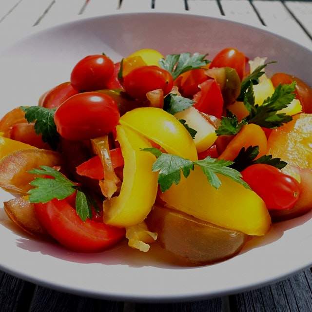 Colorful tomato salad with parsley