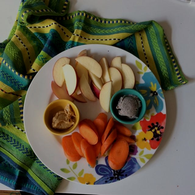 Snackin while unpackin! Apple and carrots with homemade peanut butter and cashew cream cheese.