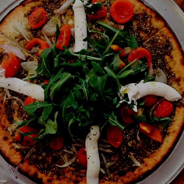 "The ""Oregano"" at Oregano. Zatar and olive oil with shallots, cherry tomatoes, arugula and labne o..."