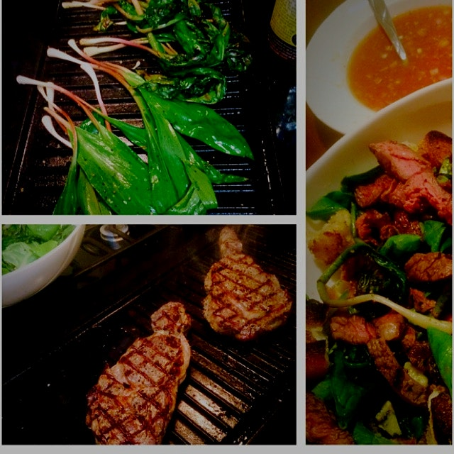 Grilled ramps and grass fed steaks over spring greens with grilled garlic crotons and a game chan...