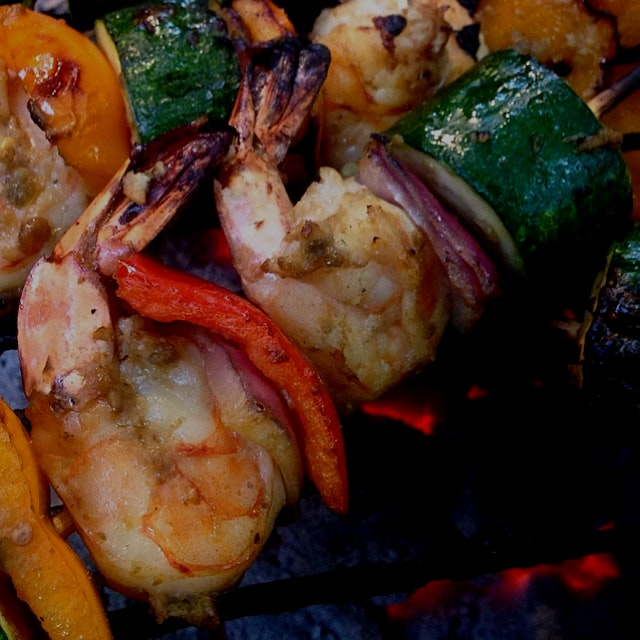 Shrimp, zukes, peppers and onions marinated in Lime Leaf Sambal and cooking on the grill. #aurias...