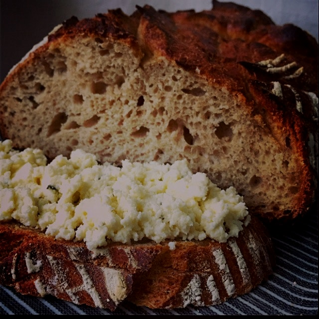 Whole wheat sourdough boule with raw milk ricotta accented with thyme and olive oil.  Hudson Vall...