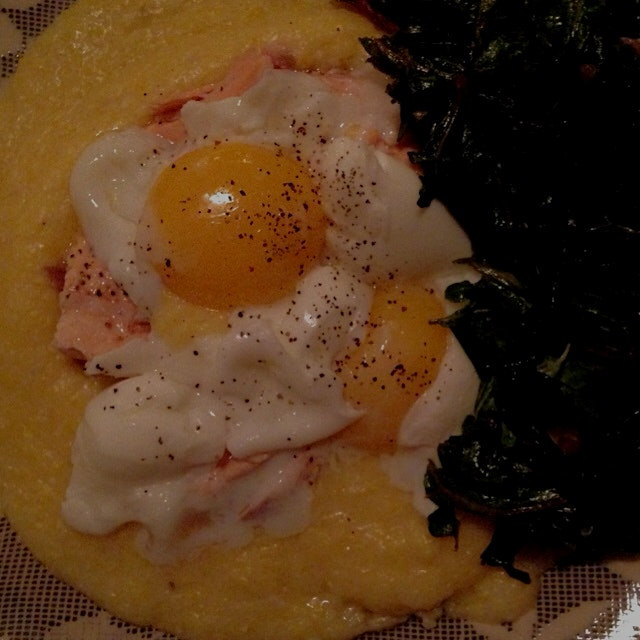 Sharp cheddar polenta with two soft boiled eggs on top -- breakfast for din!