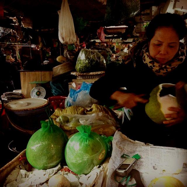 Cutting up some fresh pomelo for me! Hanoi, Vietnam
