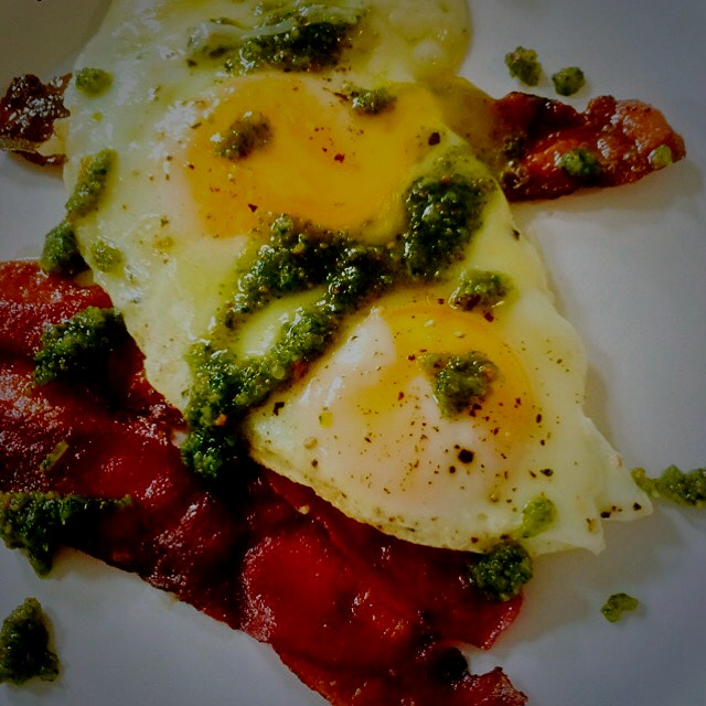 Turkey bacon and eggs with basil, mint, thyme, and pistachio pesto left over from last night's di...