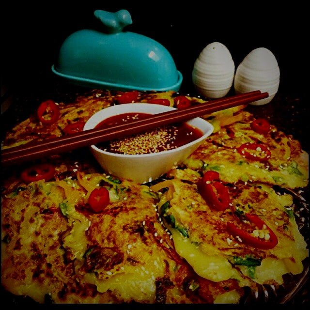 Pajeon- Korean Pancakes made with green onions and a spicy dipping sauce. Easy and tasty. Great w...