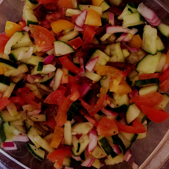 I'm convinced veggies taste better when chopped into little squares! Shepherd's salad with cucumb...