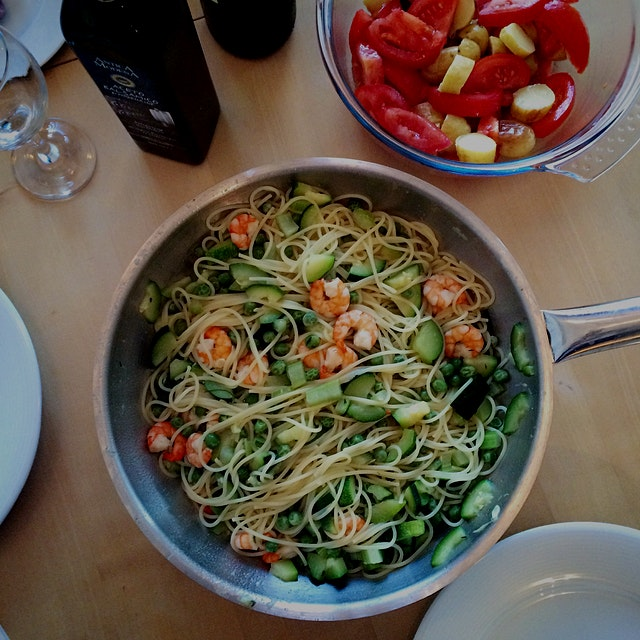 Yummy spaghettini with zucchini, green peas, celery and prawns for dinner!